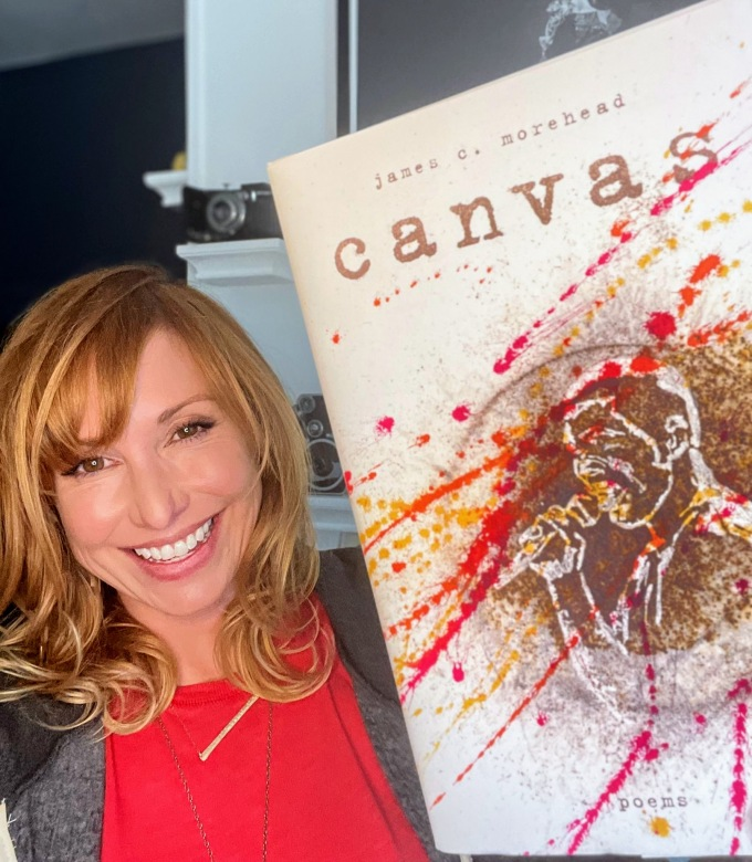 "Kari Byron holding a copy of James Morehead's book ""canvas"""